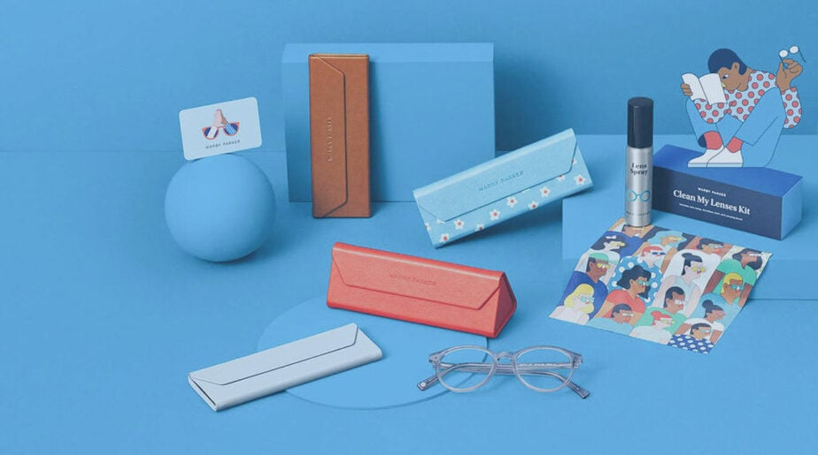 Glass cases, blue branding, Warby Parker items