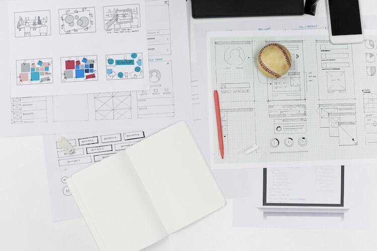 Image of website design blueprints on desk.