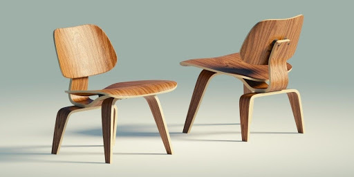 Image of mid-century modern wooden chairs designed by the Eameses.